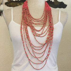 Layered coral seed bead gold tone accent necklace